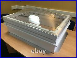 Manual opening domed clear rooflight, skylight with UPVC upstand in white